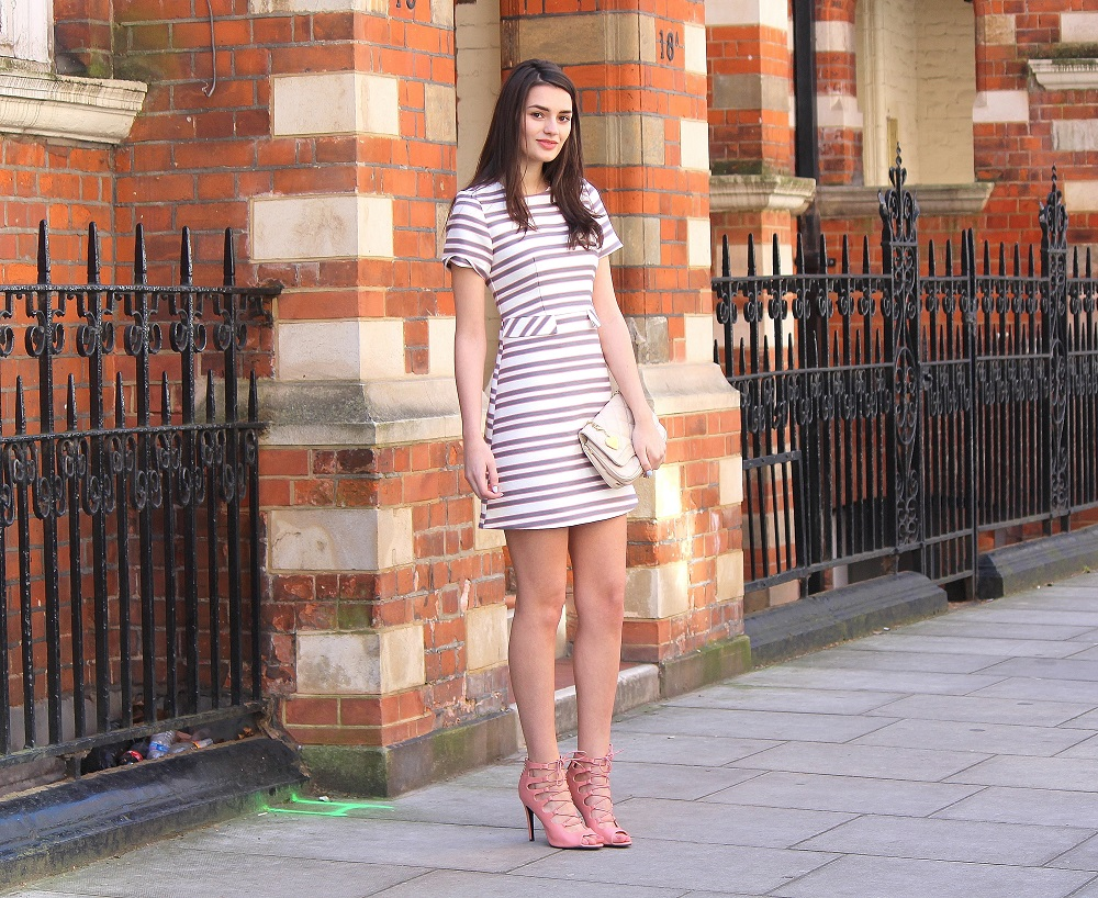 peexo fashion blogger wearing pink striped shift dress for wedding season spring