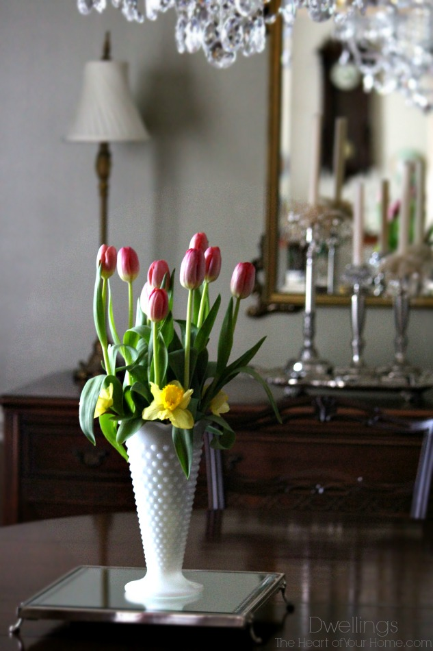 tulips and daffodils in milk glass vase
