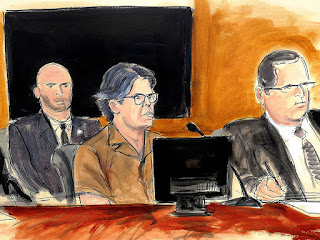 In this courtroom sketch Keith Raniere, second from right, leader of the secretive group NXIVM, attends a court hearing Friday, April 13, 2018, in the Brooklyn borough of New York.
