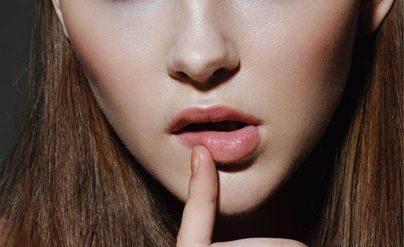 Why The Corners Of Your Mouth Crack — & How To Fix It
