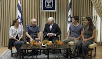 President Shimon Peres with Shalit family, Oct. 12, 2011.