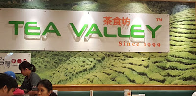 The Tea Valley backdrop at their Downtown East outlet.