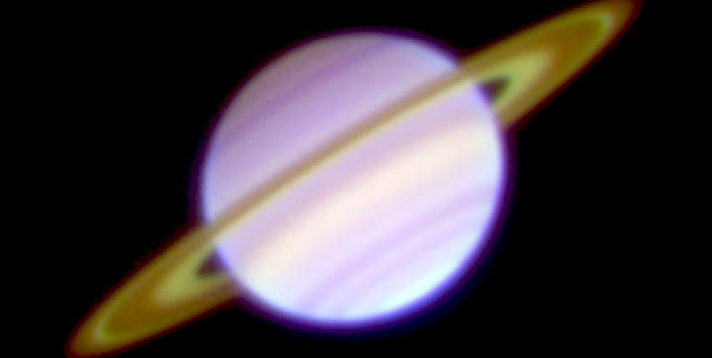 A three-color composite of the mid-infrared images of Saturn on January 23, 2008 captured with COMICS on the Subaru Telescope. The Cassini Division and the C ring appear bright. Color differences reflect the temperatures; the warmer part is blue, the cooler part is red. (Credit: NAOJ)