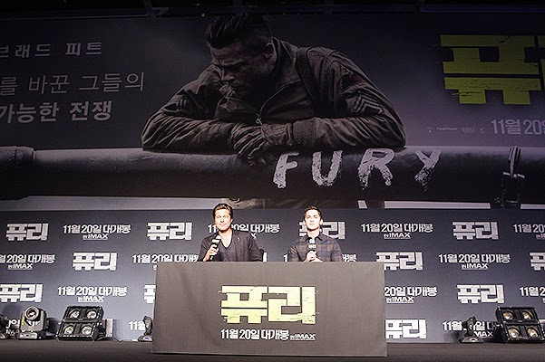 Brad Pitt and Logan Lerman in a press conference in Seoul