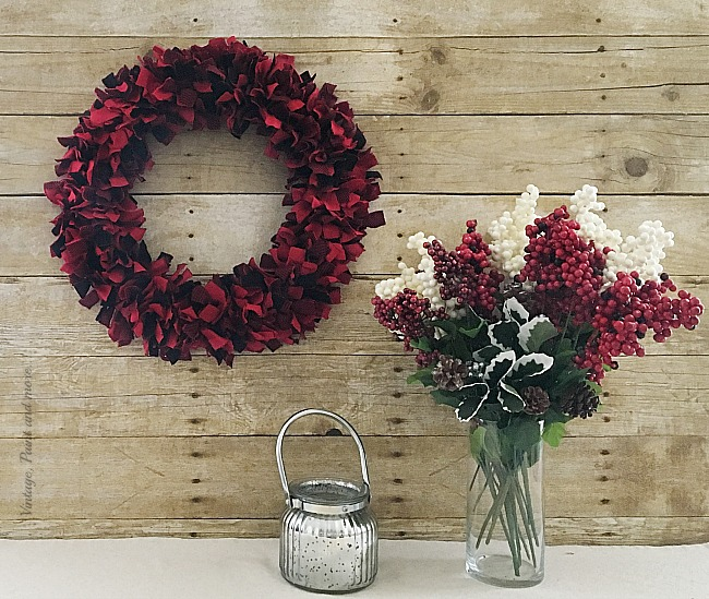 Vintage, Paint and more... rustic farmhouse vingette done with a beautiful buffalo plaid rag wreath, red and white berry and holly bouquet and a mercury candle lantern.