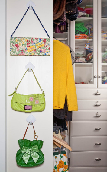 The inside of cupboard doors can be used to store accessories such as bags, ties, belts and scarves.