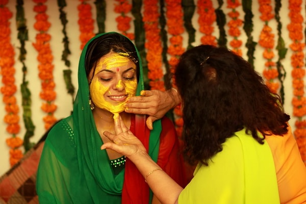 On ceremony during the wedding in India, the bride coated with turmeric, to get natural glow on the skin.