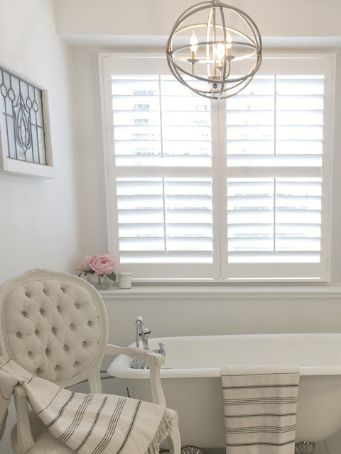 Beautiful white bathroom with classic style by Hello Lovely Studio
