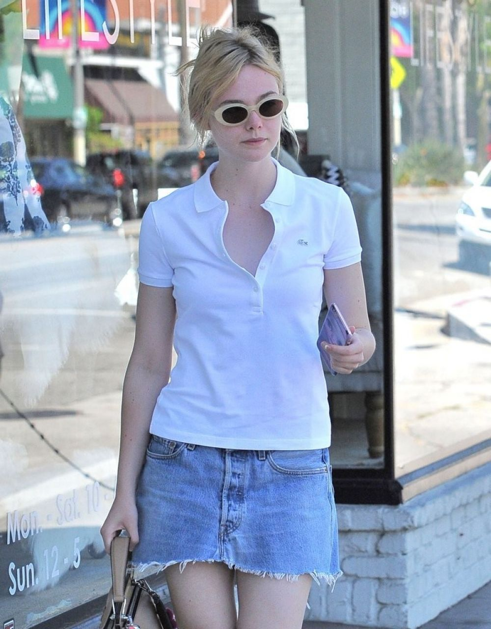 HD Photos of Elle Fanning in mini jeaans Leaves a Nail Salon in West Hollywood