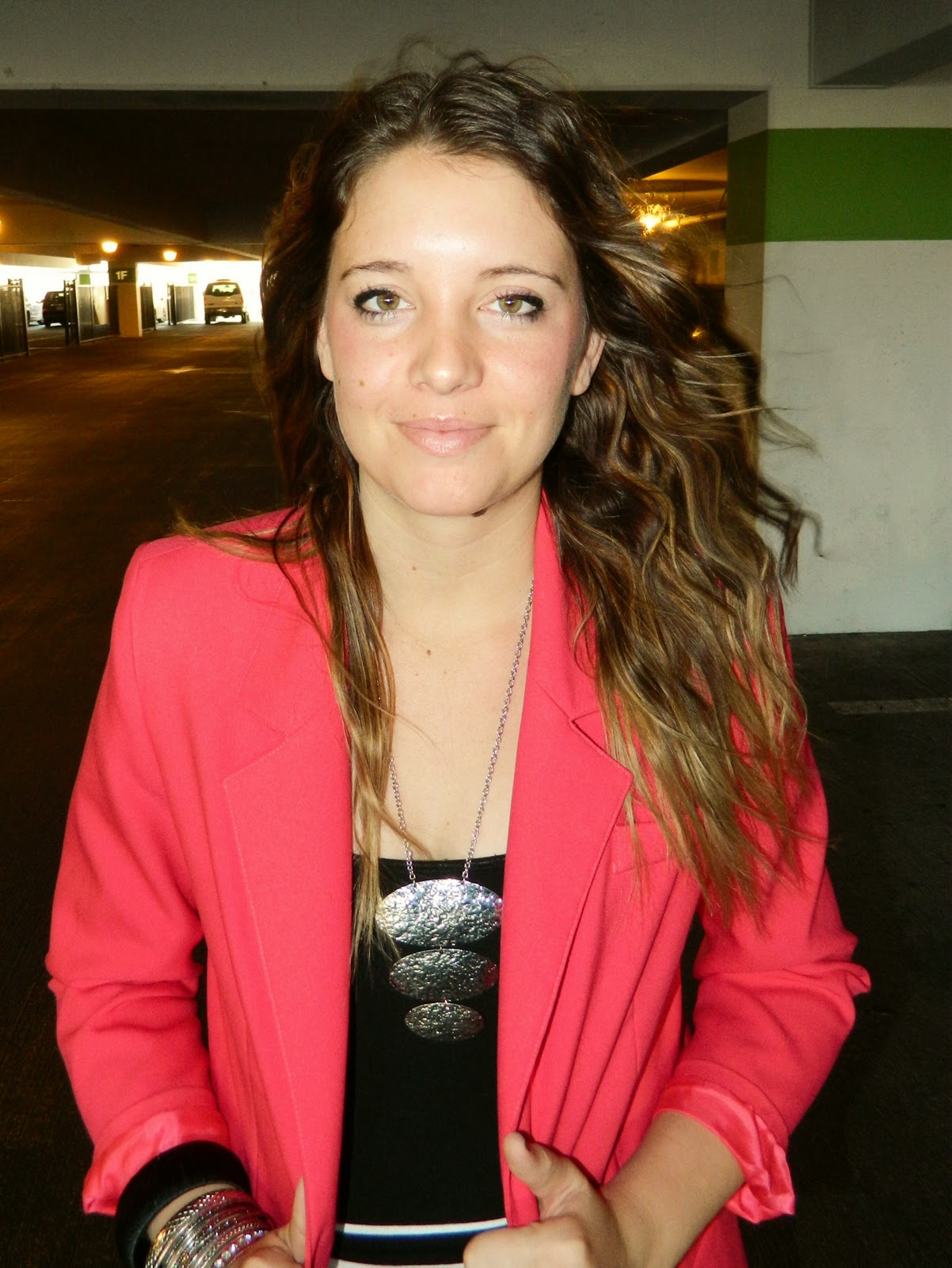 Hot pink blazer, black top