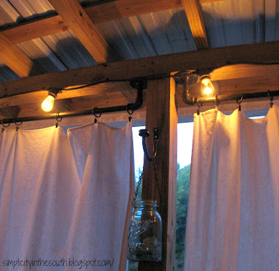 How to make a galvanized curtain rod from plumbing parts. String lights for the patio and drop cloth curtains.