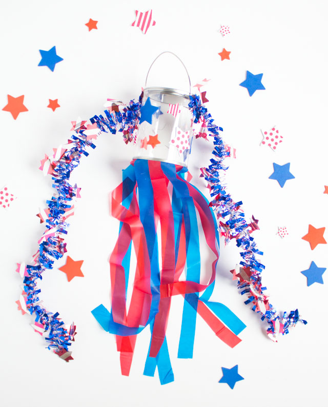Make these simple patriotic windsocks for the 4th of July with stickers, plastic tablecloths, and a clear paint can. So easy!