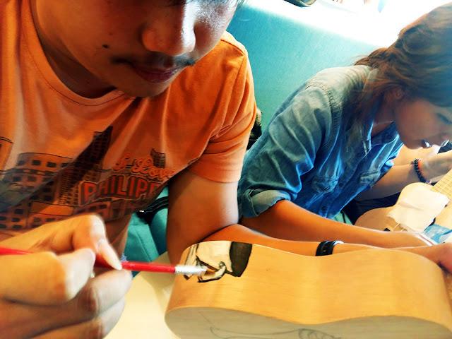 Painting a ukulele at UkeHUB Kafe in Mactan Island Lapulapu City Cebu Philippines