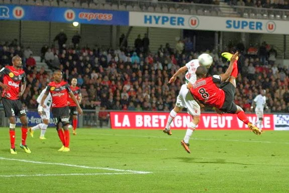 Guingamp player Claudio Beauvue scores with a scissor-kick against Ajaccio