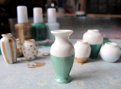 White dolls' house vase, dipped with aqua paint.