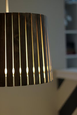 These dark stained paint sticks make the best lamp shade.