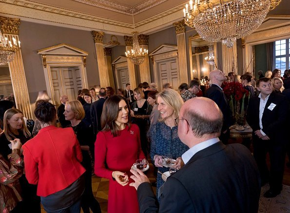 Crown Princess Mary wore a Dolce & Gabbana dress. Prada Pumps at Mary Fonden's Christmas reception