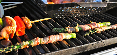 prosciutto wrapped around asparagus on grill with kabobs