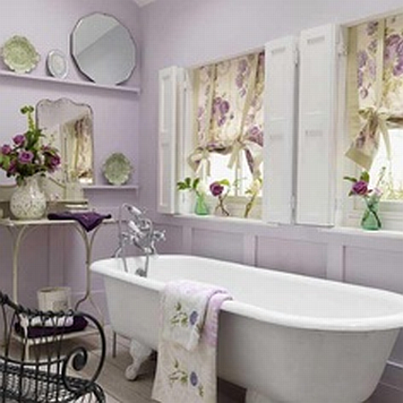 lavender bathroom with antique mirrors