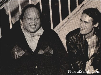 Pakistani musician Nusrat Fateh Ali Khan (1948 - 1997) (left) shares a laugh with American musician Jeff Buckley (1966 - 1997) backstage after Khans World Music Institute concert at Town Hall, New York, New York, October 7. 1995