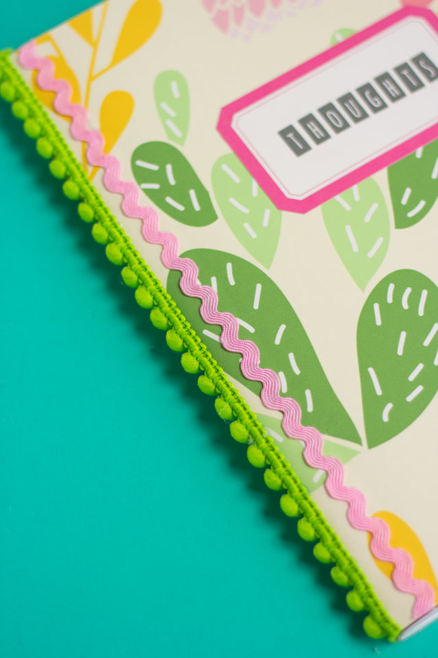 How to cover your notebooks with peel and stick vinyl and pom pom trim - so cute!