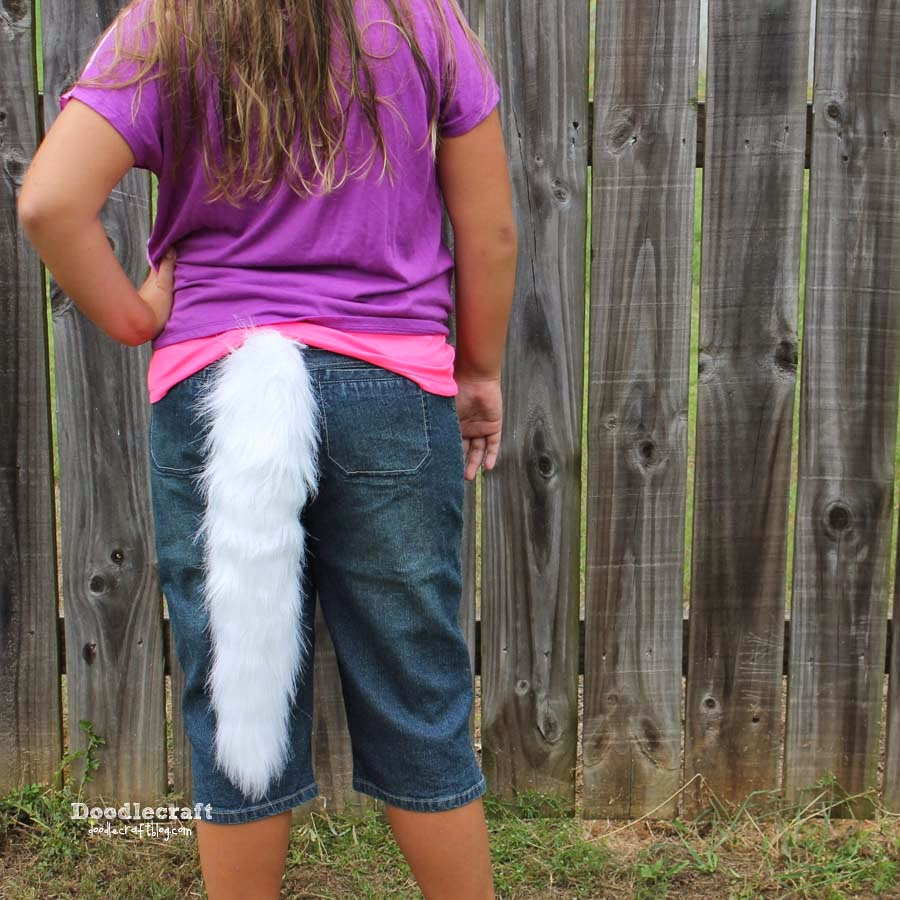 Fuzzy wolf tail made with fake fur fabric for a handmade teen wolf cosplay or costume.