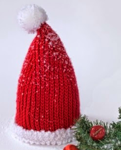 http://www.yarnspirations.com/patterns/baby-santa-hat.html