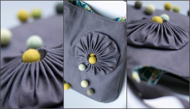genähte graue Tasche mit Filzkugeln und Rosette