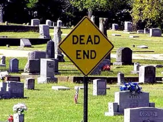 "Photo of cemetery with ironic street sign in front marked, ""Dead End."" Vanholio.com"