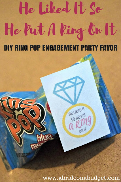 "Need a FUN and EASY engagement party favor? Make these ""He Liked It So He Put A Ring On It"" DIY Ring Pop Engagement Party Favors from www.abrideonabudget.com. PLUS, get the printable for FREE."