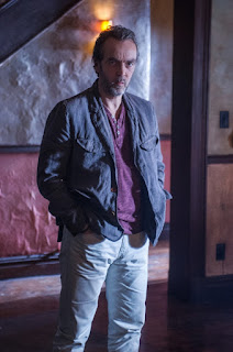 John Hannah as Rhys CBS Elementary Episode 15 A Giant Gun, Filled with Drugs