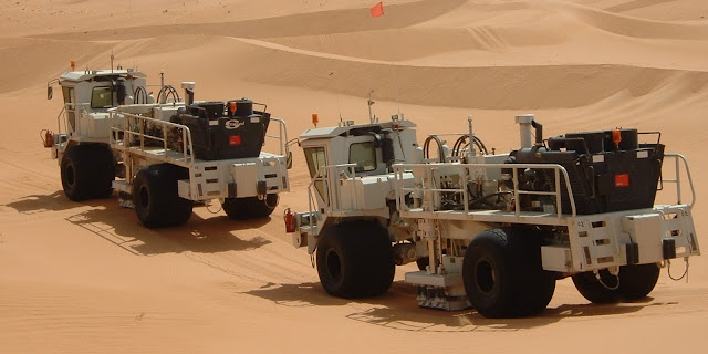 Image Attribute: File photo of vibroseis trucks for low impact 3D seismic survey