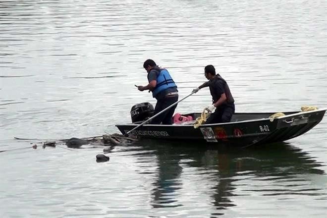 """CADÁVER FLOTANDO en CANAL de REYNOSA con """"CHALECO ANTIBALAS"""" PUESTO.. y heridas de bala. 7568501"""