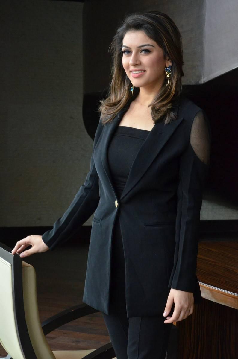Actress Hansika Motwani In Black Color Dress At Press Interview