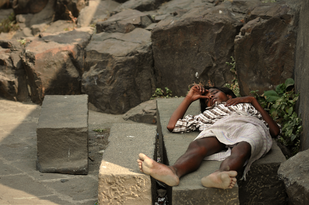 Photo of a sleeping boy at the Bandra Fort in Mumbai in India.</