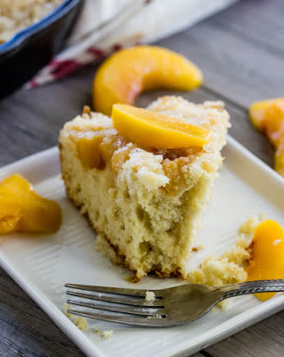slice of peach breakfast cake with bite missing
