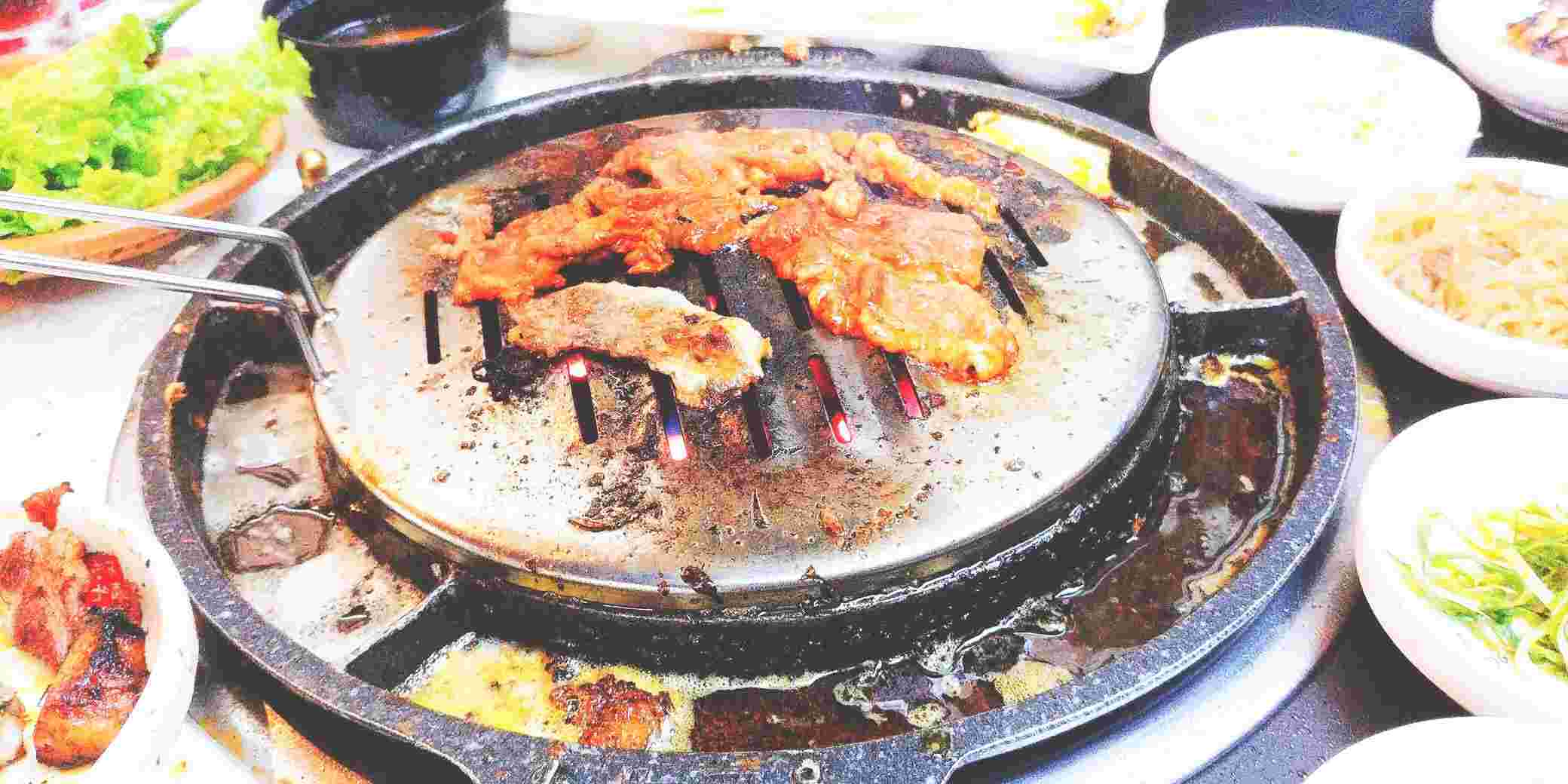 Meats on the grill at Romantic Baboy