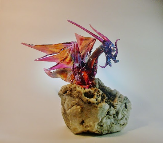 Glass Dragon on River rolled stone.