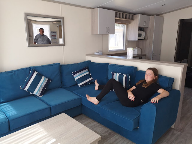 girl relaxing on caravan sofa