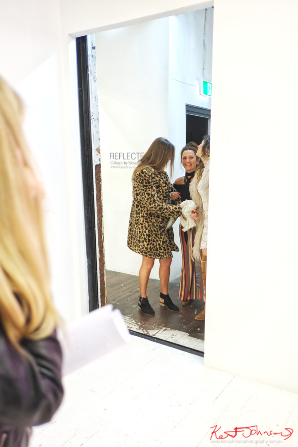 Leopard print coat, womwn prepare to enter the white cube of the China Heights Gallery space. Photography by Kent Johnson for Street Fashion Sydney.