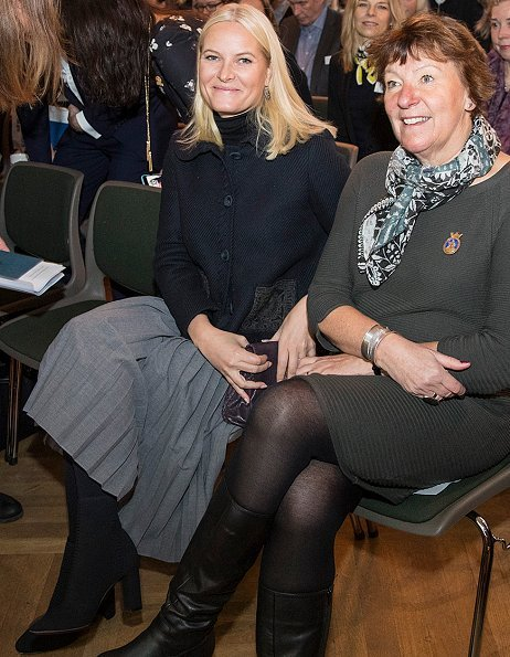 Women's Leadership for Sustainable Development. Princess Mette-Marit wore Prada Jacket, Prada boots and clutch