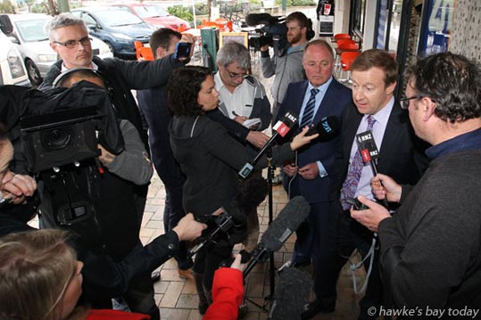 L-R: Simon Hendery, reporter, Fairfax; Annette Hilton, reporter, NZME Radio; Doug Laing, reporter, staff, Hawke's Bay Today; Craig Foss, National MP, Tukituki; Dr Jonathan Coleman, Minister of Health; Peter Fowler, reporter, Radio New Zealand - press conference on Middle Rd, Havelock North - after a gastro outbreak in Havelock North, from a Hastings District Council water supply. photograph
