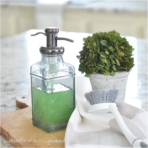What would your rather see.....A plastic bottle of dish detergent or this pretty soap dispenser?  Check out this post for an easy solution to brighten your kitchen and put a smile on your face!  | www.andersonandgrant.com