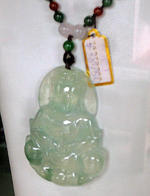 Pretty carved jade Buddha pendant with good translucency