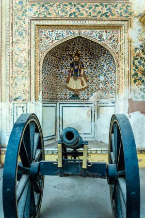 A canon and Beautiful paintings at the entrance of City Palace complex Jaipur