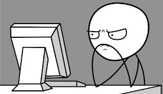 Meme de hombre malhumorado viendo la pantalla del computador de mesa