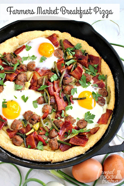 Brimming with bacon, pork sausage, & farm fresh eggs, this hearty Farmers Market Breakfast Pizza is sure to be a crowd-pleaser.