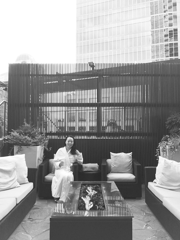 Vancouver beauty, life and style blogger Solo Lisa lounges in the outdoor area of Willow Stream Spa at Fairmont Pacific Rim