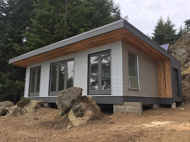 Tiny house town desolation sound modular off grid cabin for Small modular cabins and cottages