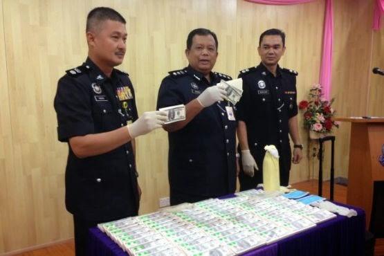 nigerian fraudster arrested malaysia